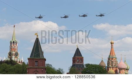 Moscow - May 7 2016: Military helicopters during the final rehearsal of the Victory parade fly over Red Square at the Spassky Tower and St Basil's Cathedral May 7 2016 Moscow Russia