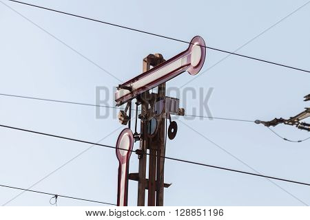a semaphore train signal on railway line