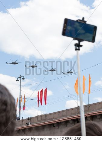 Moscow - May 7 2016: Military helicopters during the final rehearsal of the Victory Parade in Moscow and people make pictures May 7 2016 Moscow Russia