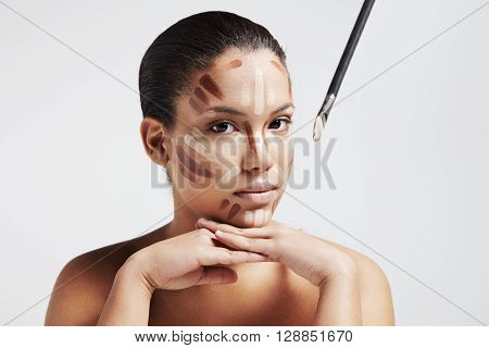 Woman With A Corrector's Lines On A Face
