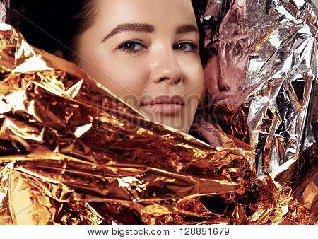 Plus Size Woman's Portrait Wraped In Golden Paper