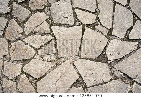 A stone wall (road) background or texture.
