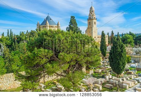 The Christian Cemetery located on the West side of the Mount Zion with the view on Dormition Abbey on the background Jerusalem Israel.