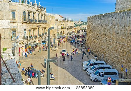 JERUSALEM ISRAEL - FEBRUARY 18 2016: The view from the city ramparts on the tourist neighborhood and the main market street on February 18 in Jerusalem.