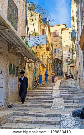 JERUSALEM ISRAEL - FEBRUARY 18 2016: The narrow street of the old residential neighborhood connects the Christian Quarter with the Muslim and Jewish on February 18 in Jerusalem.