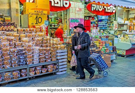 JERUSALEM ISRAEL - FEBRUARY 17 2016: The cookies and marshmallows in blister packs attracts the clients in Mahane Yehuda market on February 17 in Jerusalem.
