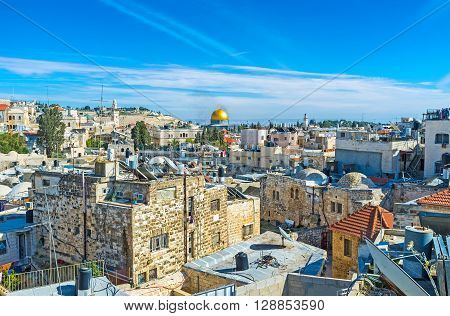 The maze of the old city with the bright golden cupola of the Dome of the Rock in the middle Jerusalem Israel.