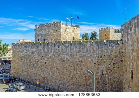 JERUSALEM ISRAEL - FEBRUARY 18 2016: The massive walls of the Davis's fortress with two towers located next to the Jaffa Gate on February 18 in Jerusalem.