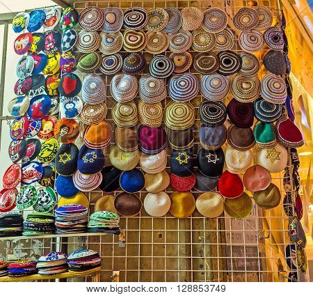 The wide range of the Jewish skullcaps with David's stars images patterns and other decorations in the souvenir store in Ben Yehuda street Jerusalem Israel.