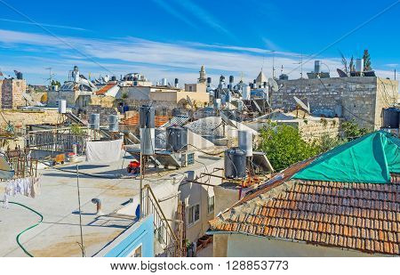 The numerous water storage tanks on the roofs of residential houses in old Jerusalem Israel.