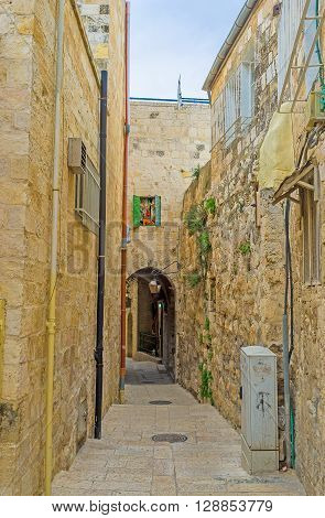 The narrow stone residential street of Armenian Quarter with the tiny passages through the houses Jerusalem Israel.