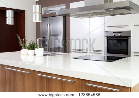 Conception of modern kitchen with household goods