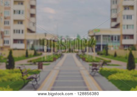 Boke. Blurring background. A new residential complex with green alleys. The park near the house. Residential complex Petrovsky quarter