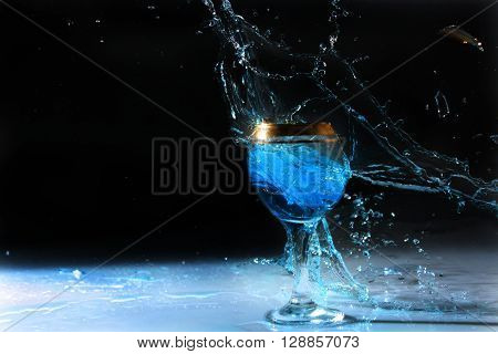 outbreak of a glass with blue water