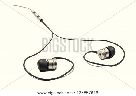 headphones stacked in heart shape on isolated toned background executed in macro style