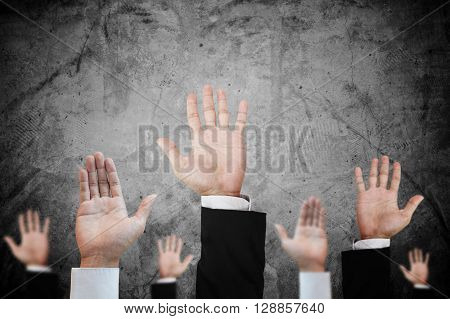 Hands raising upward on concrete background, abstract concept and ideas
