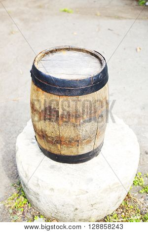 an Old wooden barrel with iron rings