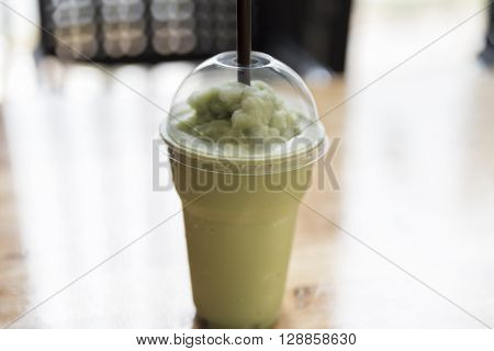 Green Tea Smoothie On Wooden Table