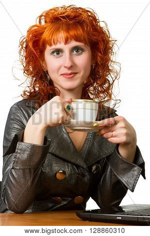 A young woman holding a cup of coffee at her workplace on a white background