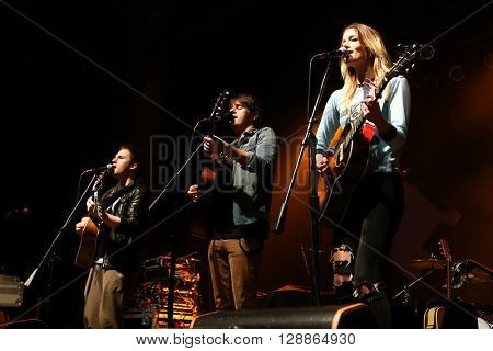 HUNTINGTON, NY-MAR 26: (L-R) Elijah Edwards, Mason Van Valin and Megan McAllister of Fairground Saints perform onstage at the Paramount on March 26, 2016 in Huntington, New York.