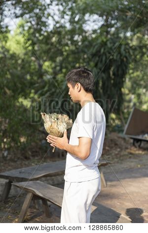 Young Man Praying Before Buddhist Monk Ordination Ceremony