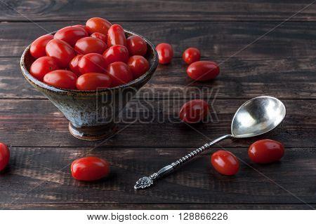 Cherry Tomatoes In Ceramic Bowl.