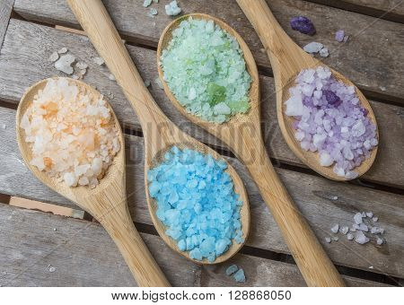 Bath Salts in brilliant colors contrasting wood.
