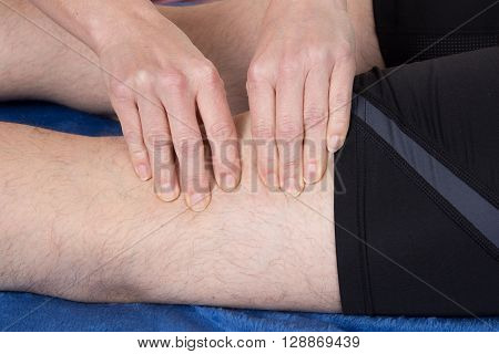 Physio Therapist Giving  Massage To A Man