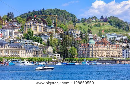 Lucerne, Switzerland - 8 May, 2016: view on the city over Lake Lucerne with Hotel Montana and Hotel Palace buildings. Lucerne is a city in central Switzerland, it is the capital of the Swiss Canton of Lucerne.