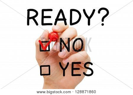 Hand putting check mark with red marker on No Ready. Readiness survey concept.