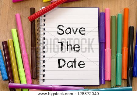 Save the date text concept and colored pens
