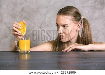 Squeezing Orange On Table