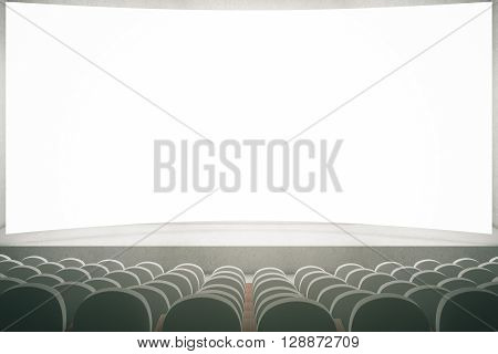 Movie theater with rows of grey seats and large blank screen. Mock up 3D Rendering