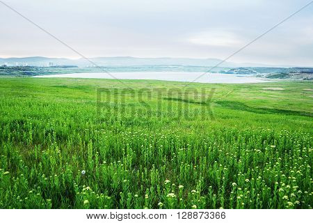 spring evening photo of Lake Most viewed from the verdant fields in North Bohemia landscape