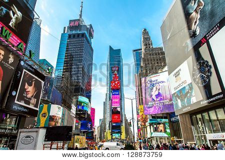 NEW YORK, USA - MAY 7, 2016: Unidentified people on the Times Square New York. Times Square is the most popular tourist location in New York City.