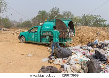 PAI, THAILAND - April 10, 2016 : Garbage truck of Pai Subdistrict Administrative Organization dumping Garbage at the garbage disposal pond in Pai,Thailand