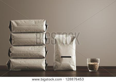 Retail Pack: Big Hermetic Package With Blank Label Presented Near Other Four Lying Pouches Filled Wi