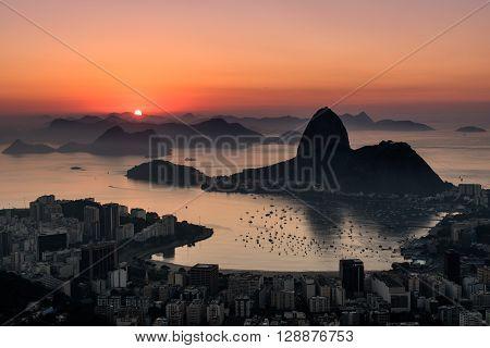 Beautiful Sunrise over Guanabara Bay in Rio de Janeiro with Sugarloaf Mountain in the Horizon