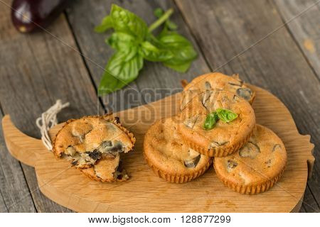 tasty homemade muffins with eggplant and fresh basil