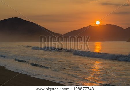 Beautiful Sunrise at the beach with hills sand grass and beautiful tones