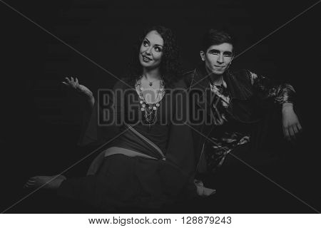Acting. Man and woman in an interesting way on a dark background.