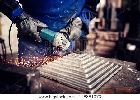 Industrial Engineer Working On Cutting A Metal And Steel Bar With Angle Grinder, Metallurgic Factory