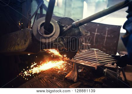 Factory Worker, Laborer Cutting And Grinding Steel Using Grinder Power Tool