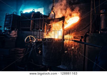 Liquid Iron Flowing In Steelworks. Industrial Details Of Metallurgic Factory Or Plant. Details Of Sm