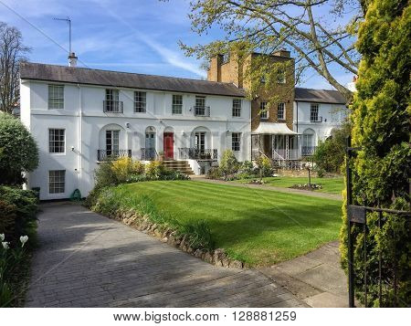 LONDON - MAY 5: Quaint terraced houses and their well-maintained front gardens on May 5, 2016 in Hampstead, London, UK.