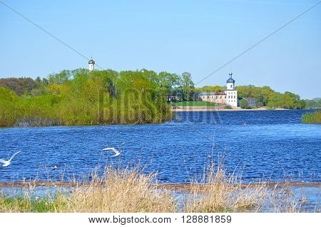 Architecture spring rural landscape in nice sunny weather - Volkhov river and Yuriev monastery in Veliky Novgorod Russia. Selective focus at the monastery
