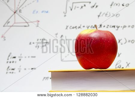the apple and a text book at school