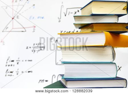stack of books on magnetic board background.