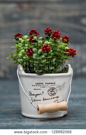 Artificial Red Flower In A Flowerpot