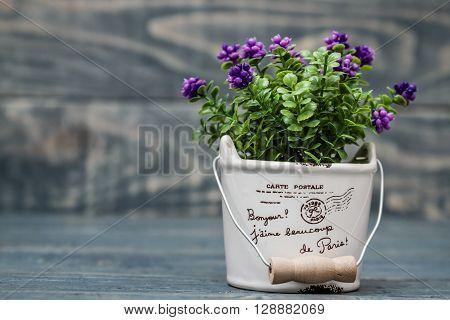 Artificial Purple Flower In A Flowerpot